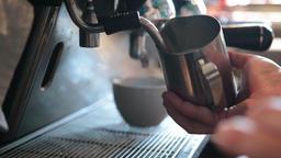 Barista steaming milk to prepare cappuccino Live Action