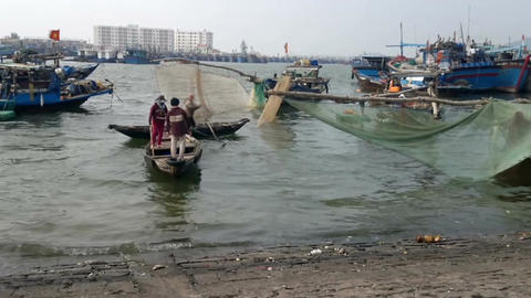 View of Vietnamese fishermen and their boat leaving the dockside, Da Nang, South Footage