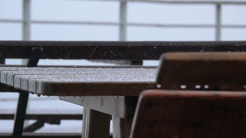 Outdoor Table and Bench. Rain and Hail. Slow Motion Footage