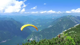 Paraglider over Mountains and Lkes. UHD Footage