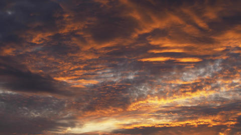 Timelapse from sunset with dramatic clouds Warm orange and cold blue colors is Live Action
