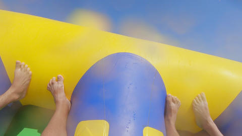 Riding on an inflatable attraction Footage