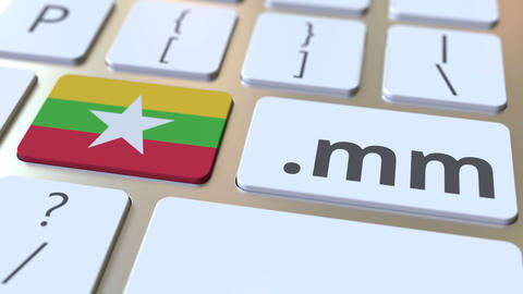 Myanma domain .mm and flag of Myanmar on the buttons on the computer keyboard Live Action