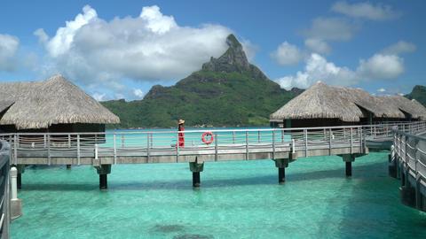 Bora Bora Vacation Travel woman walking on paradise motu beach French Polynesia Footage