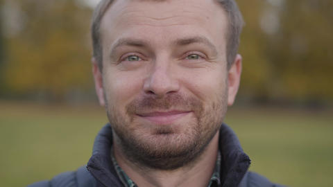 Close-up face of an adult caucasian man looking at the camera and making faces Live Action