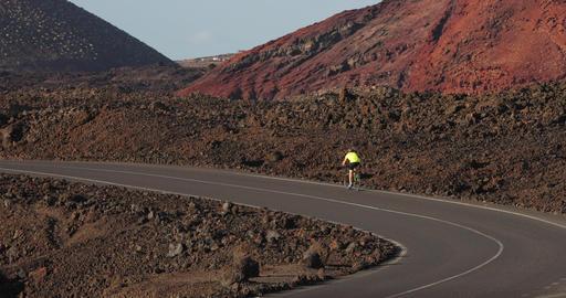 Road biking man cyclist biking on road bike cycling in amazing nature landscape Live Action