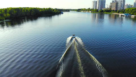 Speed boat moving fast on the river, aerial view Footage