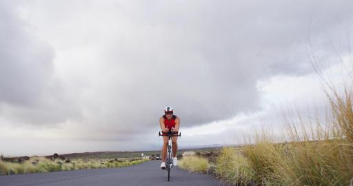 Triathlon man cycling - male triathlete biking on triathlon bike Live Action