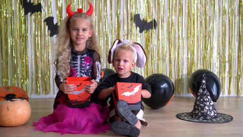 children waiting for candy in their Halloween outfits. trick or treat concept GIF