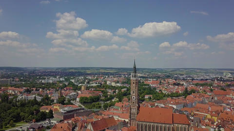 Aerial view on a huge german city with a big tower with gothic architecture, 4k Live Action