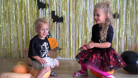 kids cheer each other on Halloween costumes. October dark evil witch fest. 4K Live Action