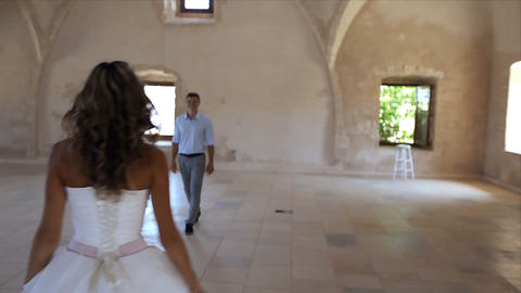 Happy bride and groom having fun in an old castle Footage