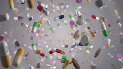 Flying through Assorted Colorful Pills on White Live Action