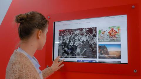 Woman using interactive display wall Live Action