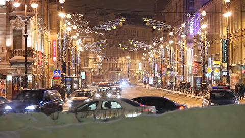 Winter city street mouth ahead, perspective view, evening time traffic Footage