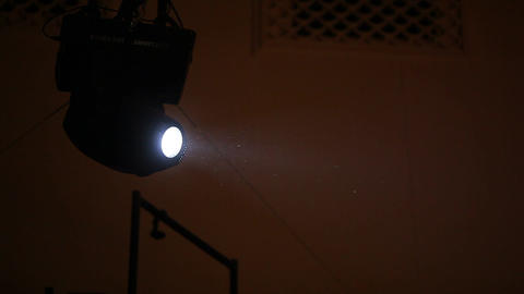 Bright light beam illuminate motes in air, small dust particles fly in ray Footage