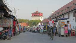 Road in Batavia with food stalls and watchtower for port,Jakarta,Java,Indonesia Footage