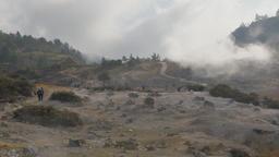 Tourists walk towards Kawah Sikidang volcanic crater,Dieng,Java,Indonesia Footage
