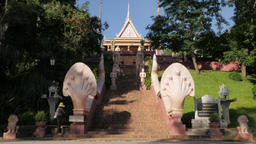 Woman sweeping at entrance Wat Phnom,Phnom Penh,Cambodia Footage