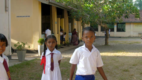 Sinhalese schoolchildren on schoolyard lit by sun Archivo