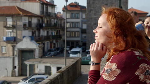 Enjoying the sun in the historic district of Porto - CITY OF PORTO, PORTUGAL - Footage