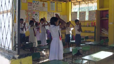 Sinhalese schoolchildren pray standing in classroom Footage