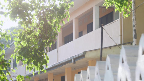 empty school building with large balcony at green trees Archivo