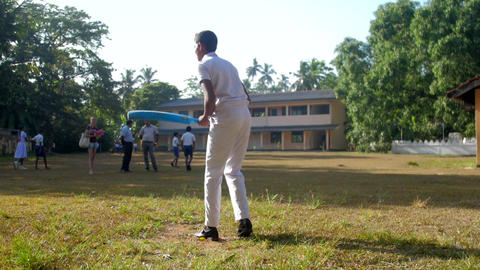 Sinhalese boy in uniform prepares for cricket game Archivo