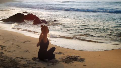 tremendous lady meditates doing yoga on sandy beach Footage