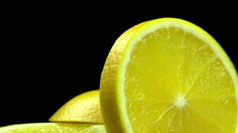 A round slice of yellow orange appears from the bottom of the screen Footage