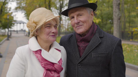 Smiling mature Caucasian couple in elegant clothes looking at the camera and Footage