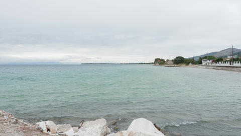 Calm sea waves smashing into rock seashore Live Action