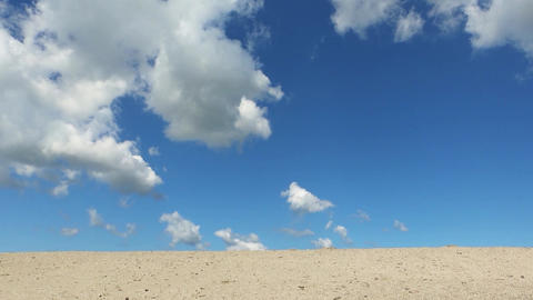 Blue sky, clouds and sand ビデオ