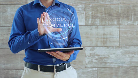 Man uses hologram with text Social commerce Live Action