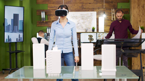 Female architects exploring virtual reality project of business buildings Footage