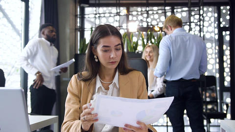 Attractive young two businesswomen working together with financial reports and Footage