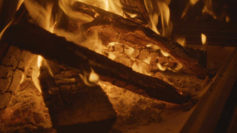Fire burning in fireplace. Fireplace full of fire wood and fire Live Action