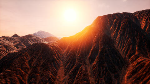 Sun Rays over Mountains in a Valley Footage
