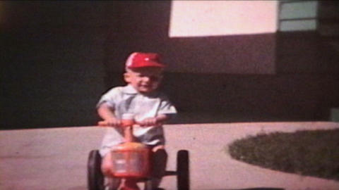 Boy Rides Tractor Outside 1964 Vintage 8mm Film stock footage