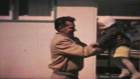 Little Boy Jumps To His Dad 1963 Vintage 8mm film Stock Video Footage
