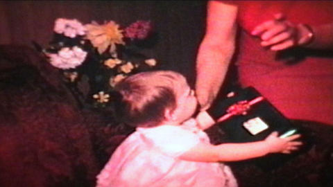 Little Girl With Christmas Gift 1966 Vintage 8mm film Stock Video Footage