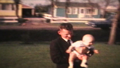 Proud Parents Holding Baby Outdoors 1963 Vintage 8mm film Stock Video Footage