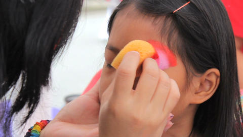 Little Asian Girl Has Eyes Face Painted Stock Video Footage