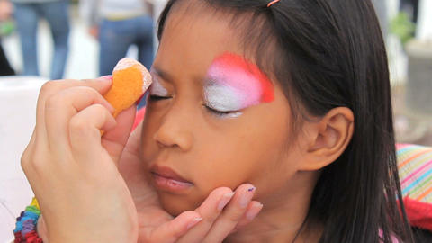 Little Asian Girl Has Eyes Face Painted Footage