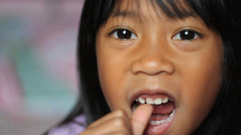 Little Girl Wiggling Her Loose Front Tooth Footage