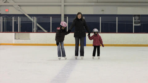 Mother Ice Skates With Her Daughters Stock Video Footage