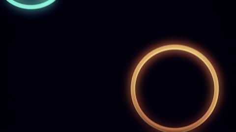 Falling, Bouncing Neon Rings in Slow Motion Loop Stock Video Footage