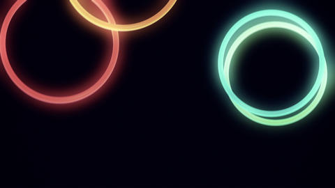 Falling, Bouncing Neon Rings in Slow Motion Loop Stock Video Footage