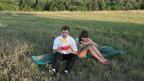 Young couple eating watermelon at picnic, closeup view Stock Video Footage
