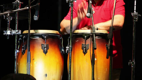 Man playing percussion on the concert Footage